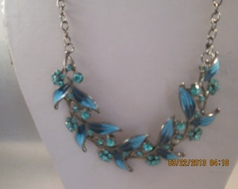 Deep Silver Tone Chain Necklace with Shades of Blue Leaves and Blue Rhinestones Pendant