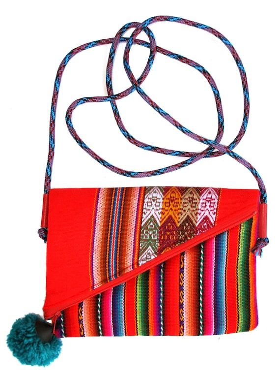 Small, pom pom, adjustable strap, red Peruvian, stripes, cross body bag, flat bag