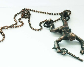 Copper Toy Soldier necklace.