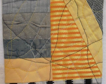 Fiber Art Wall Hanging, contemporary art,orange,yellow and grey redirected  fabrics  create a  contemporary art quilt for the smaller space.