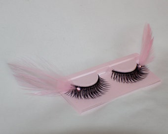 Light pink and black feather lashes with light pink jewels