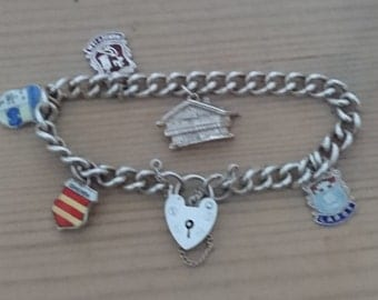 Vintage sterling silver charm bracelet with four Shields and one charm