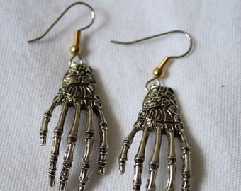 "Dangling earrings. ""Skeleton Hands"""