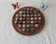 "14"" Solitaire Game,  38 Individual Semi Precious Stone Marbles on Hardwood Playing Board from Madagscar"