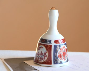 Vintage white ceramic bell with Asian style images / small dinner bell with golden trim