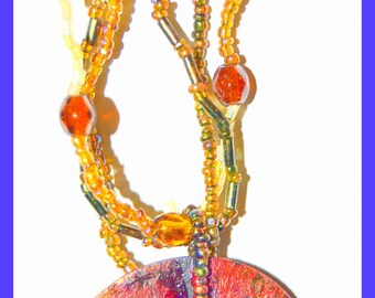 colorful beaded and painted disc necklace