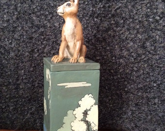 Tall ceramic box with a sculpture of a hare on the lid