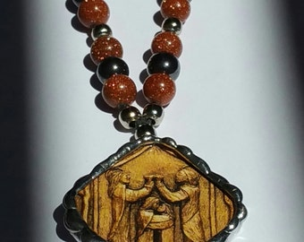 The Wedding at Cana necklace with hematite and golden sand beads hand-soldered pendant