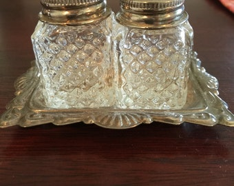 Vintage mini salt and pepper shakers with silver metal tray