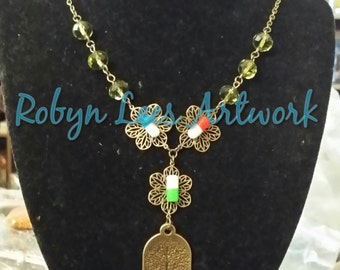 Yggdrasil Tree of Life and Pill Capsules Bronze Necklace with Filigree Flowers and Olive Green Beads
