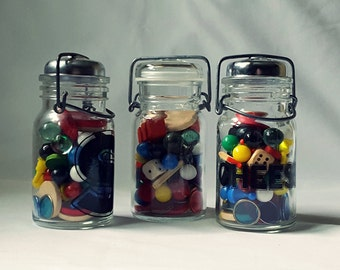 Vintage Set of Three Canning Jars Filled with Colorful Game Pieces, Dice, Marbles