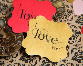 I love you gift wrap stickers, envelope seals. Red gold love stickers. Square pearlised seals. Luxury gift wrappings. Square valentines