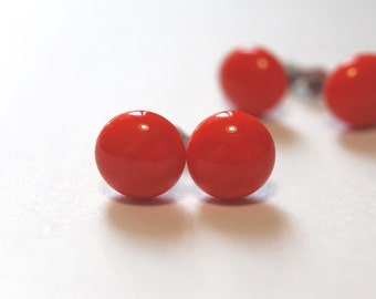 Light red glass studs on titanium posts