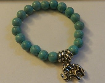 Turquoise Magnesite beaded Stretch bracelet  with silver Elephant V4470