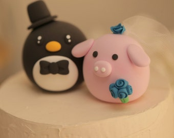 Penguin abd pig  wedding cake topper