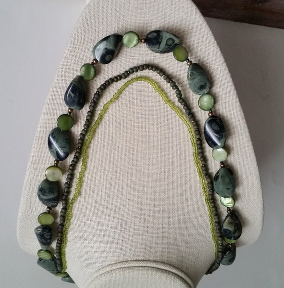 KAMBABA JASPER NECKLACE Triple Strand with Green Mother of Pearl and Seed Beads. Flat Twisted Beads. Olive Green and Gold. 21 Inch Size..