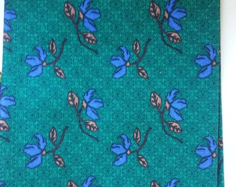 Fat quarter fabric, floral pattern, dark emerald green with blue flowers