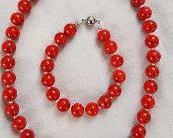 Coral with freshwater pearls