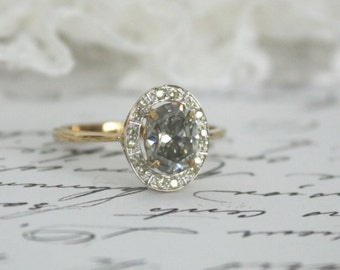 9K Yellow Gold Ring with 1.10 carat Grey Oval Moissanite in a White Gold Diamond Halo