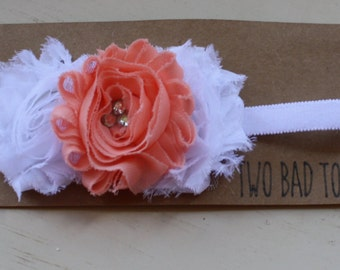 Sweet triple rosette headband with rhinestone accents in centre flower! Size 12 months
