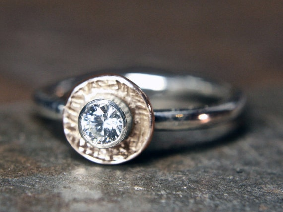 Recycled sterling silver solitaire engagement ring set with 1/4ct lab grown diamond or moissanite. Handmade in the UK