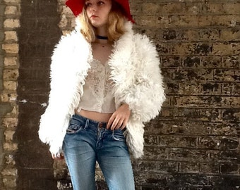 Vintage white faux fur jackets