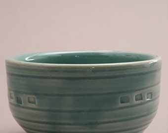 Set of two small seafoam blue bowls with square details.