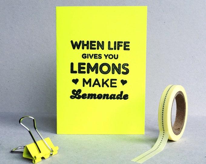 Neon yellow hand printed 'when life gives you lemons, make lemonade' mini card