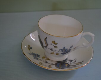 Lovely tea cup and saucer set. Blue flowers/leaves. Vintage.