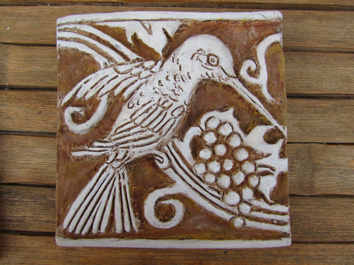 Hummingbird bas relief inspired by the batchelder and malibu