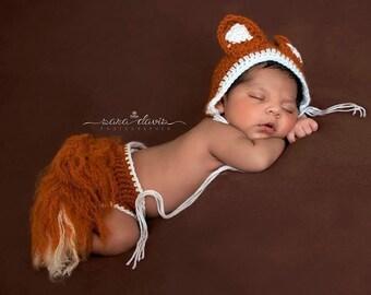 Fox set bonnet and bushy tail.