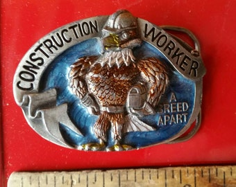 """FREE Shipping belt buckle Vintage  1988 **Construction  Worker A BREED APART**  Western excellent condition approximately 3"""" wide"""