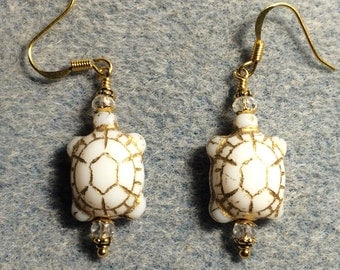 White Czech glass turtle bead earrings adorned with clear Chinese crystal beads.