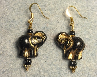 Black Czech glass elephant bead dangle earrings adorned with black Czech glass beads.