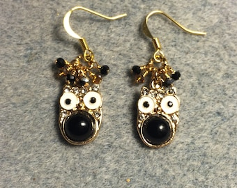 Black and white enamel and rhinestone owl charm earrings adorned with tiny dangling black and amber Chinese crystal beads.