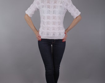 Chic in vintage knitted sweater with an elaborate pattern
