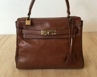 REDUCED - Vintage Myers smooth brown leather Kelly bag with keys and padlock 1940. Made in USA.