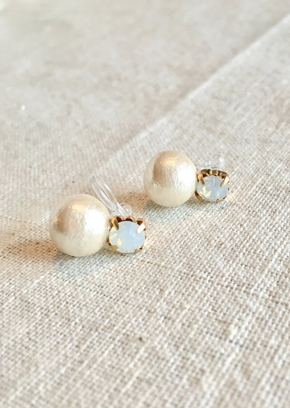 Looks like pierced Cotton pearl opal earrings with invisible