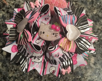Kitty boutique hairbow with an attached frnech barrette on the back.