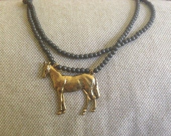 Gray Beaded Necklace with Gold Horse