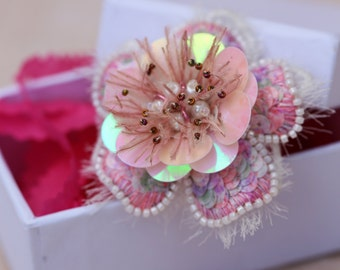 A large flower ring pink prodee on silk with sequins and Japanese beads