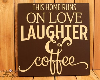 This home runs on love laughter and coffee hanging wood sign