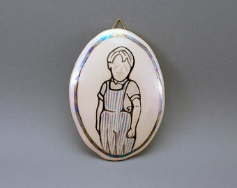 """ceramic illustration """"Olek"""", drawing of a boy with shimmery mother of pearl luster"""