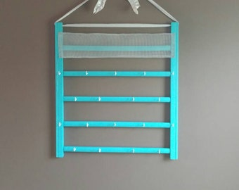 Blue jewelry hanger