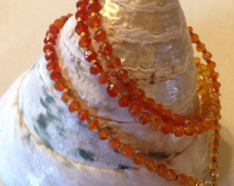 Faceted Carnelian and24k gold delica bead 20inch necklace/tripple wrap bracelet