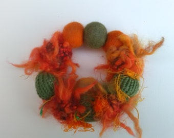 Unique knitted and needle felted bracelet