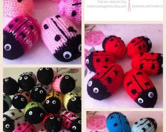 Rainbow knitted ladybugs