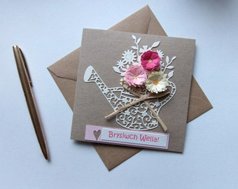 "Brysiwch Wella Welsh Get Well Card with Quilled Flowers and Lacy Watering Can Size 5"" x 5"""