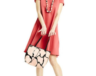 Trapezoid dress with longer back in coral