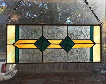 Teal and amber stained glass window hanging